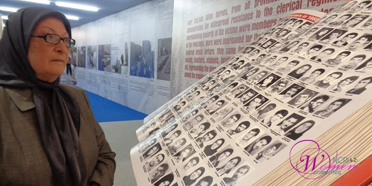 Fereshteh Akhlaghi looks on at the List of 20,000 PMOI Martyrs