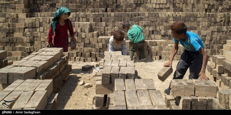 """""""Our salaries are very low in the face of high prices and inflation,"""" said Nashmil, a woman working in a brick kiln workshop"""