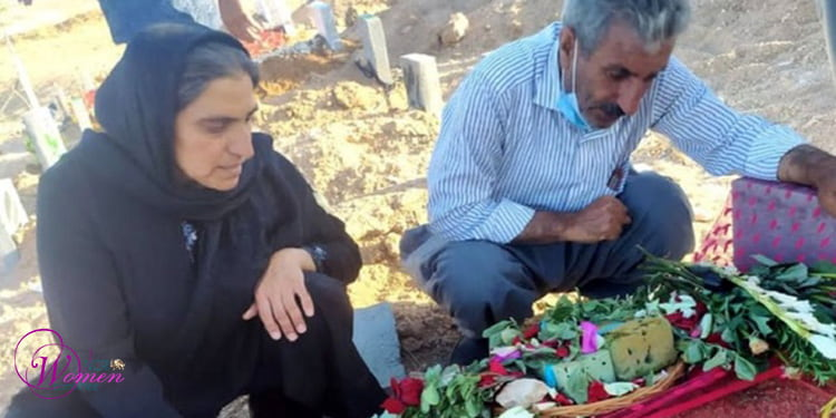 Golaleh Sheikhi's parents at the side of her grave