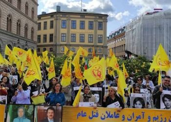 Iranians rally and march in Stockholm seeking justice for the 1988 massacre victims
